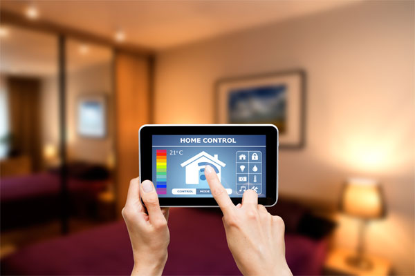 Image of a person using a smart home app on a tablet