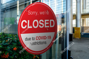 """Photo of a red and white """"closed"""" sign"""